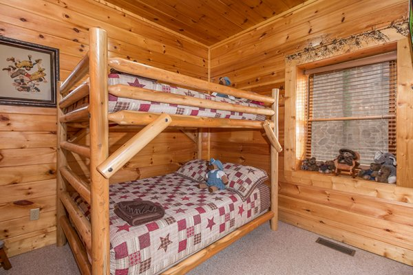 Full-sized bunk bed at Bearfoot Lodge, a 5-bedroom cabin rental located in Pigeon Forge