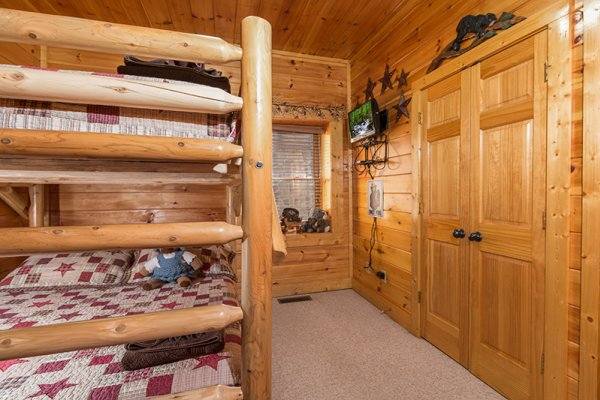 Bunk beds at Bearfoot Lodge, a 5-bedroom cabin rental located in Pigeon Forge
