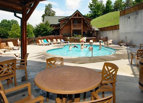 Outdoor pool and deck at Bearfoot Lodge, a 5-bedroom cabin rental located in Pigeon Forge