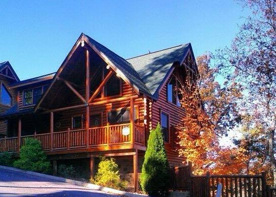 Front of the cabin in fading light at Bearfoot Lodge, a 5-bedroom cabin rental located in Pigeon Forge