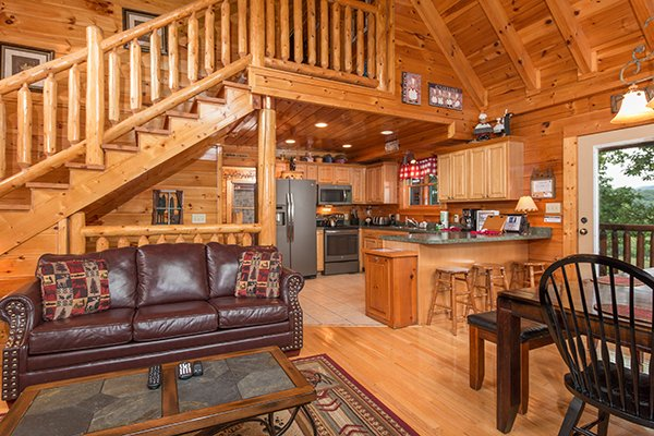 Open concept living room and dining space at Bearfoot Lodge, a 5-bedroom cabin rental located in Pigeon Forge