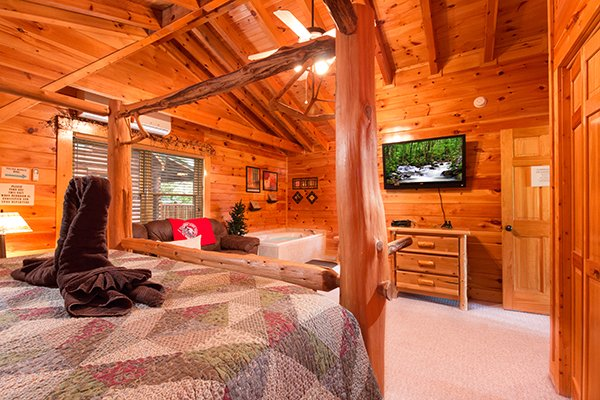 Loft bedroom with television and dresser at Bearfoot Lodge, a 5-bedroom cabin rental located in Pigeon Forge
