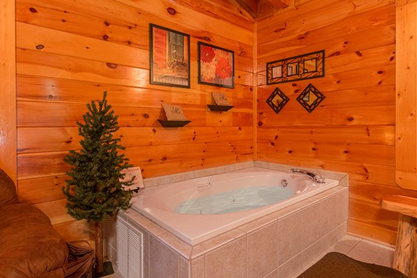 Jacuzzi tub in the loft at Bearfoot Lodge, a 5-bedroom cabin rental located in Pigeon Forge