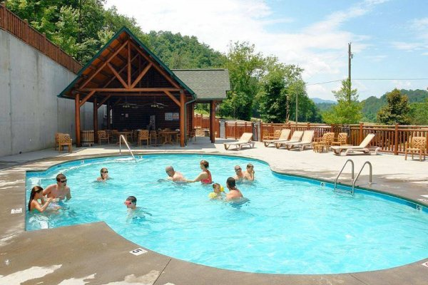 Outdoor resort pool at Bearfoot Lodge, a 5-bedroom cabin rental located in Pigeon Forge