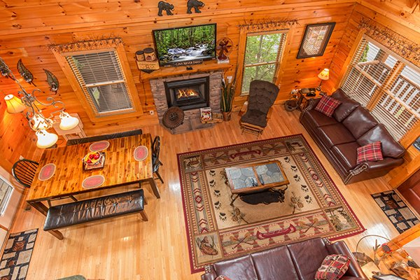 View of the living room from upstairs at Bearfoot Lodge, a 5-bedroom cabin rental located in Pigeon Forge