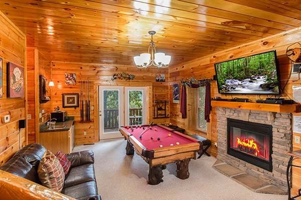 Red felted pool table in the game room at Bearfoot Lodge, a 5-bedroom cabin rental located in Pigeon Forge