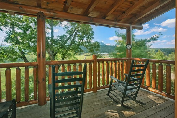 Rocking chairs on the porch overlooking the mountain views at Bearfoot Lodge, a 5-bedroom cabin rental located in Pigeon Forge