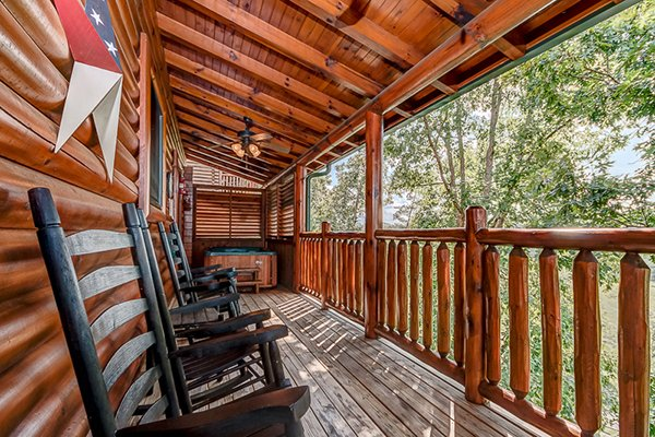 Rocking chairs on the covered deck at Bearfoot Lodge, a 5-bedroom cabin rental located in Pigeon Forge
