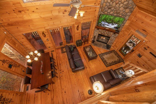 Looking down at the living and dining rooms at All Hours, a 2 bedroom cabin rental located in Pigeon Forge