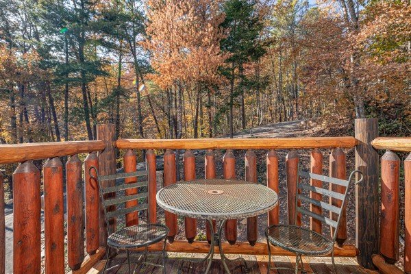 Bistro set for two on the deck at All Hours, a 2 bedroom cabin rental located in Pigeon Forge