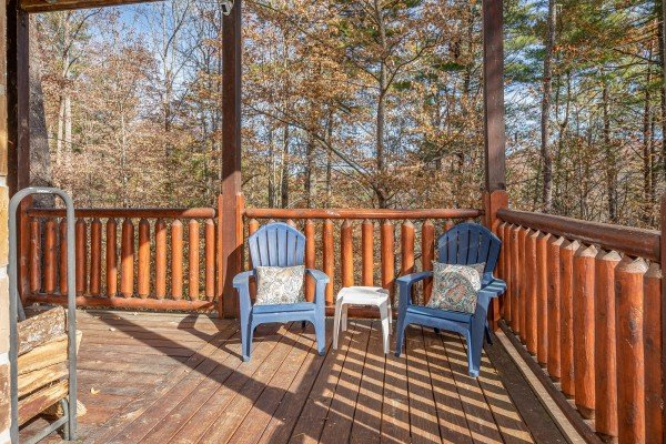 Adirondack chairs on the deck at All Hours, a 2 bedroom cabin rental located in Pigeon Forge