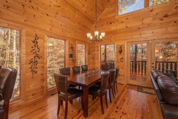 Dining room table for eight at All Hours, a 2 bedroom cabin rental located in Pigeon Forge