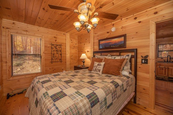 Bedroom with a nightstand and lamp at All Hours, a 2 bedroom cabin rental located in Pigeon Forge