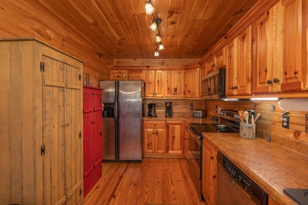 Kitchen with stainless appliances and two pantry closets at All Hours, a 2 bedroom cabin rental located in Pigeon Forge