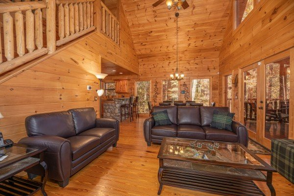Sofa and loveseat in the living room at All Hours, a 2 bedroom cabin rental located in Pigeon Forge