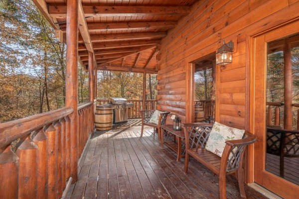 Propane grill and furniture on a deck at All Hours, a 2 bedroom cabin rental located in Pigeon Forge