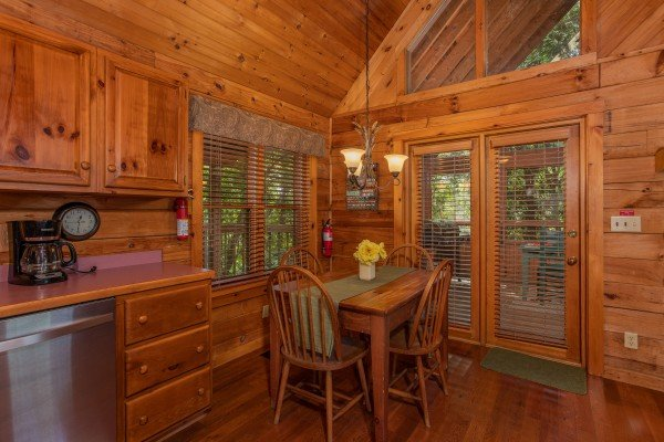 Dining space for four at Golden Memories, a 1-bedroom cabin rental located in Pigeon Forge