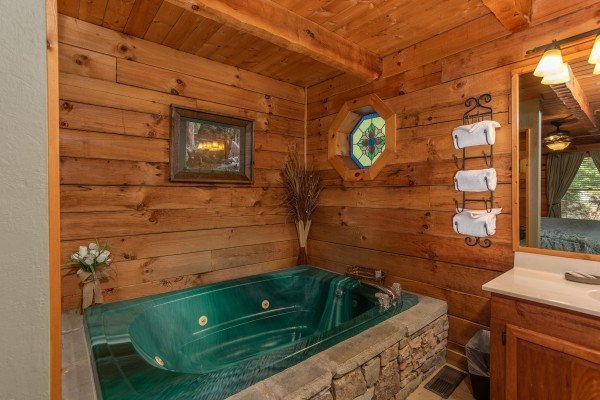 Jacuzzi tub on the main floor at Golden Memories, a 1-bedroom cabin rental located in Pigeon Forge