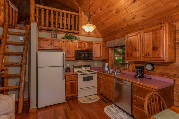 Kitchen with all major appliances at Golden Memories, a 1-bedroom cabin rental located in Pigeon Forge
