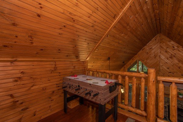 Foosball table in the loft at Golden Memories, a 1-bedroom cabin rental located in Pigeon Forge