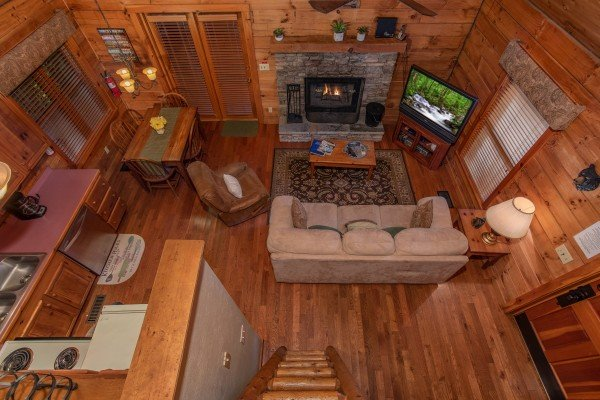Looking down to the main floor from the loft at Golden Memories, a 1-bedroom cabin rental located in Pigeon Forge
