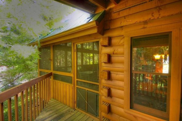 Access to the screened porch from the deck at Golden Memories, a 1-bedroom cabin rental located in Pigeon Forge