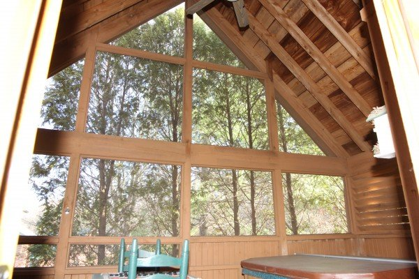 Screened in porch with a vaulted ceiling at Golden Memories, a 1-bedroom cabin rental located in Pigeon Forge