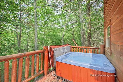 Deck with hot tub at Moose on the Loose, a 1 bedroom cabin rental located in Gatlinburg