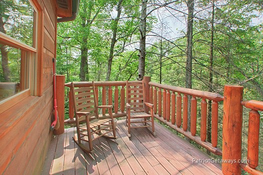 Deck with rocking chairs at Moose on the Loose, a 1 bedroom cabin rental located in Gatlinburg