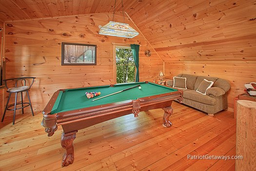 lofted game room with pool table and sofa bed at moose on the loose a 1 bedroom cabin rental located in gatlinburg
