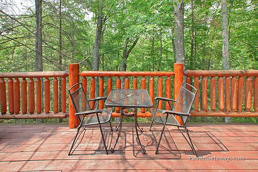 Deck dining for two at Moose on the Loose, a 1 bedroom cabin rental located in Gatlinburg