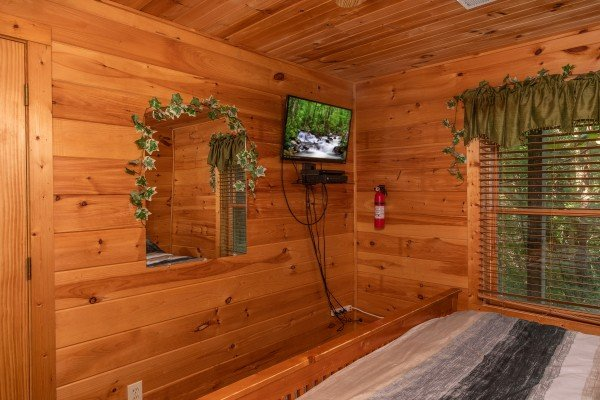 wall mounted television in a bedroom at angel's majestic view a 3 bedroom cabin rental located in pigeon forge