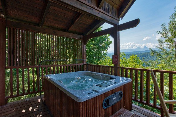 hot tub on a covered deck with mountain views at angel's majestic view a 3 bedroom cabin rental located in pigeon forge