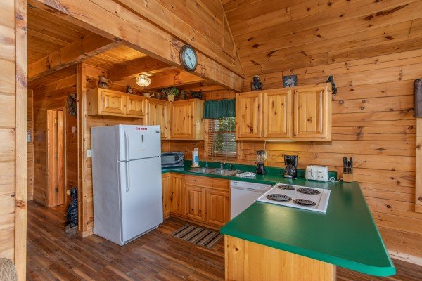 kitchen with white appliances at angel's majestic view a 3 bedroom cabin rental located in pigeon forge