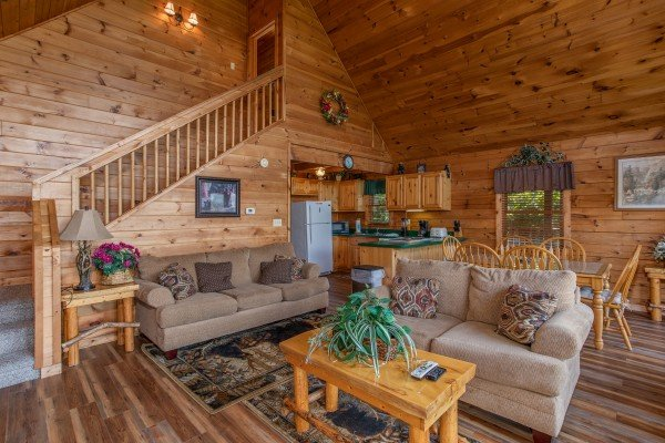 living room with sofa and love seat at angel's majestic view a 3 bedroom cabin rental located in pigeon forge