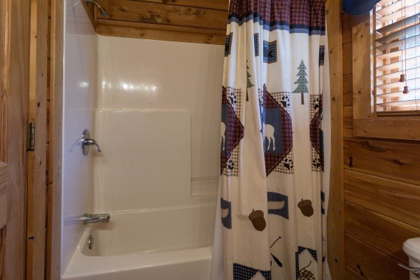 bathroom with tub and shower at angel's majestic view a 3 bedroom cabin rental located in pigeon forge