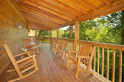 deck with rocking chairs at mickey's playhouse a 2 bedroom cabin rental located in pigeon forge