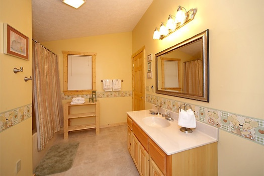 en suite bathroom at mickey's playhouse a 2 bedroom cabin rental located in pigeon forge