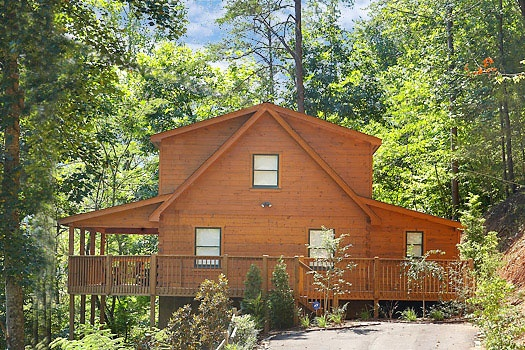 exterior view with parking area at mickey's playhouse a 2 bedroom cabin rental located in pigeon forge