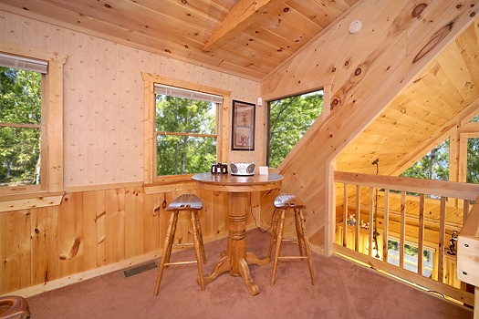loft area seating at mickey's playhouse a 2 bedroom cabin rental located in pigeon forge