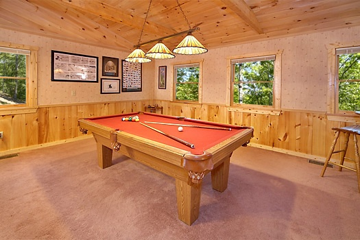 lofted game room with pool table at mickey's playhouse a 2 bedroom cabin rental located in pigeon forge