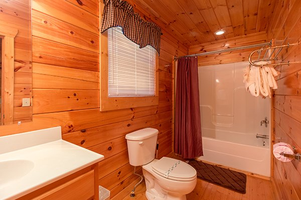 bathroom with a tub and shower at a beautiful memory a 4 bedroom cabin rental located in pigeon forge