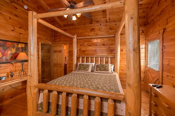 Log four post bed at A Beautiful Memory, a 4 bedroom cabin rental located in Pigeon Forge