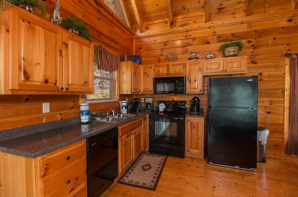 kitchen at a beautiful memory a 4 bedroom cabin rental located in pigeon forge