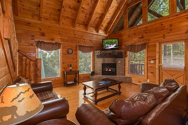 Fireplace in the living room at A Beautiful Memory, a 4 bedroom cabin rental located in Pigeon Forge