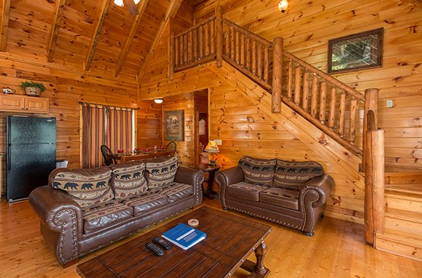 couch and loveseat in living room at a beautiful memory a 4 bedroom cabin rental located in pigeon forge