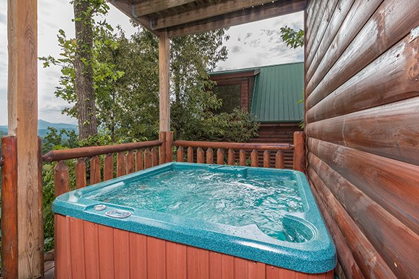 Hot tub on a covered deck at A Beautiful Memory, a 4 bedroom cabin rental located in Pigeon Forge