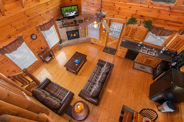 overhead view of the living room and kitchen at a beautiful memory a 4 bedroom cabin rental located in pigeon forge