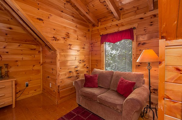 love seat in a window nook at a beautiful memory a 4 bedroom cabin rental located in pigeon forge