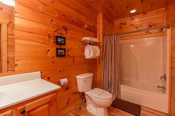 bathroom with tub and shower at a beautiful memory a 4 bedroom cabin rental located in pigeon forge